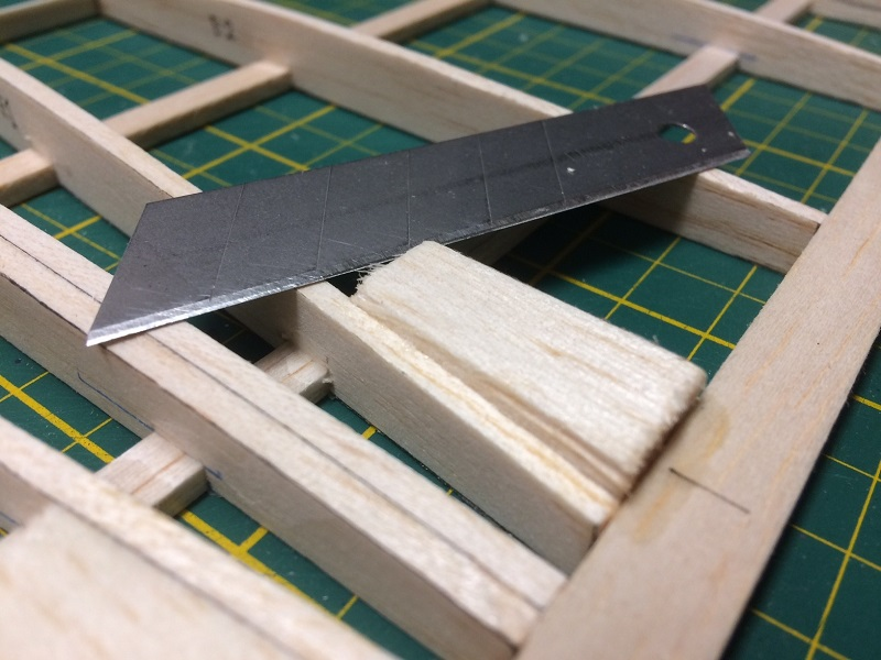 045 cutting hinge blocks to shape after glueing in place.jpg
